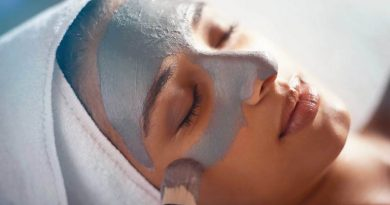 grey clay mask on girls face