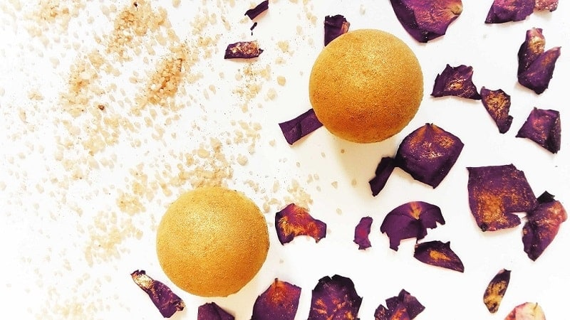 yellow DIY bath bombs covered in golden mica powder