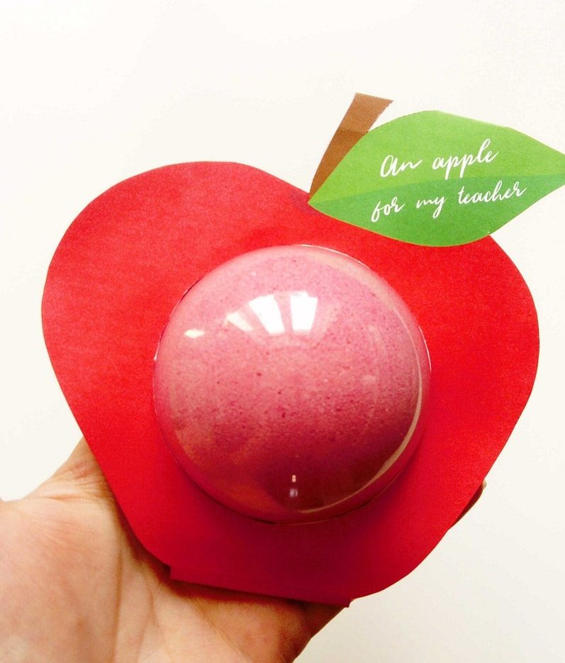 Free printable bath bomb holder ina  shape of red apple designed to be presented as a homemade teacher gift