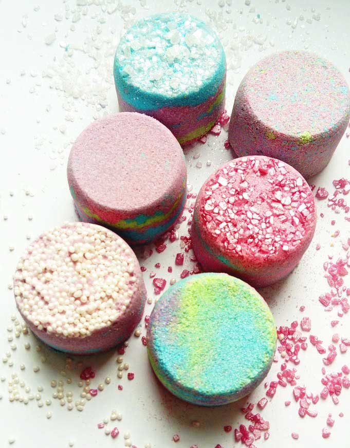 A set of mini bath bombs all with different colors and finishes