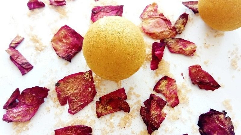 DIY moisturizing bath bomb fully painted with golden mica powder
