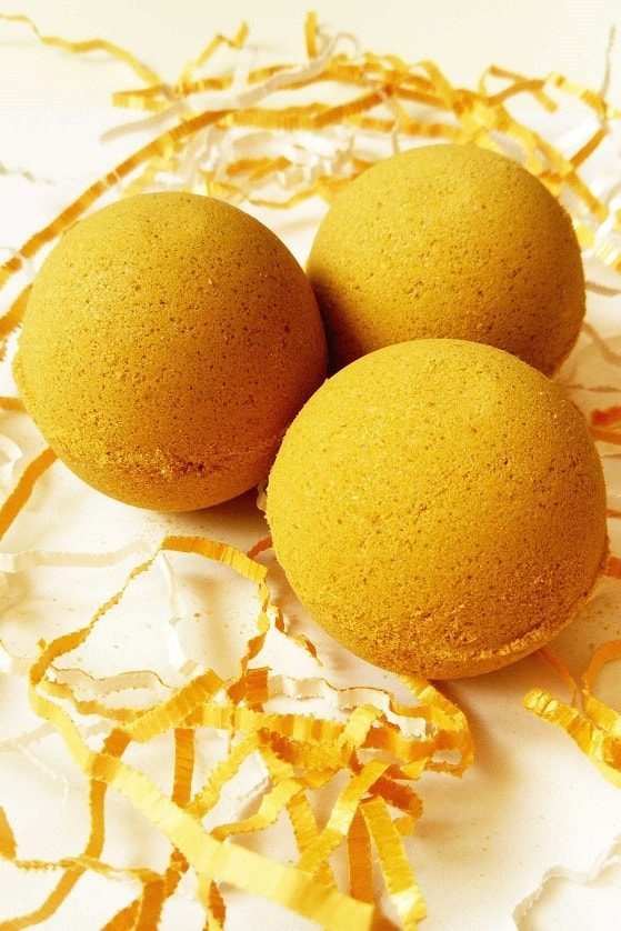 DIY bath bombs dark yellow color ready to be painted in gold