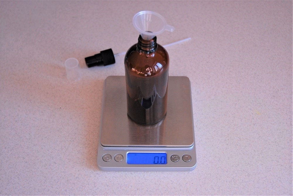 Measuring ingredients for homemade hair spray for dry hair