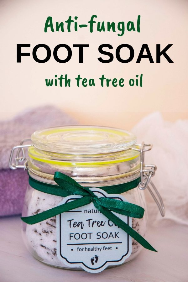 Homemade antifungal foot soak with tea tree oil packed in a gift jar with green tag and matching ribbon