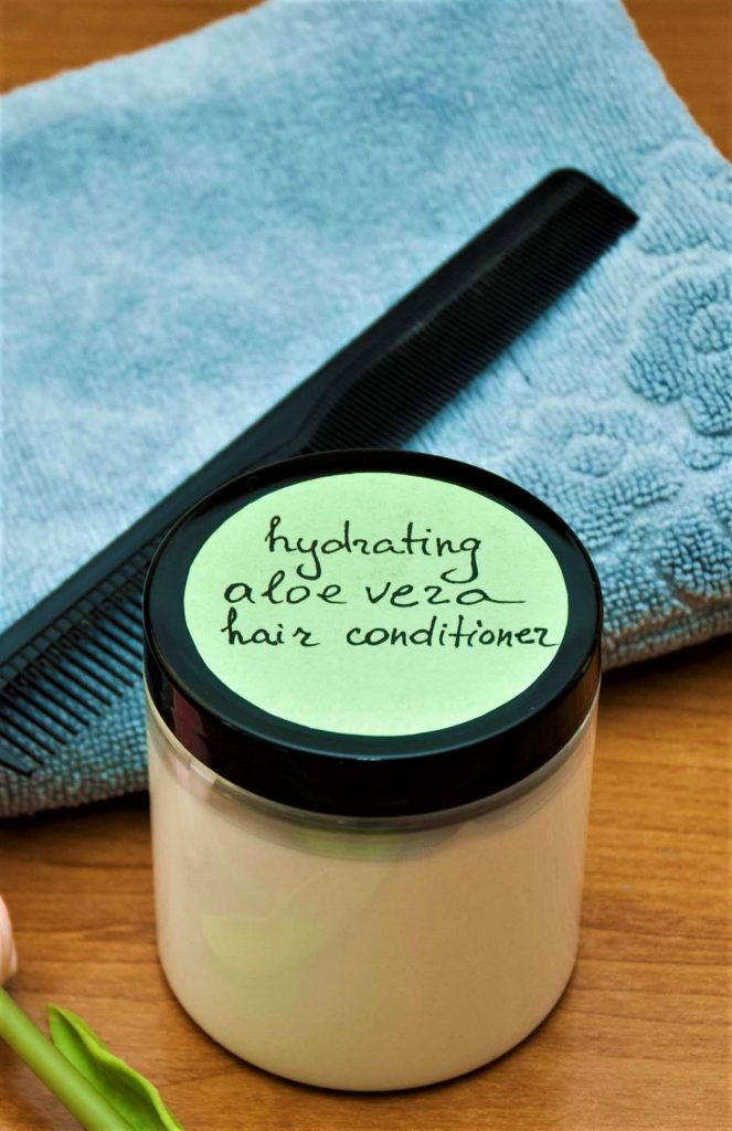 moisturizing aloe vera diy conditioner for hair that is dry next to towel and hair brush