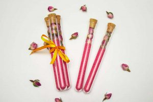 pink DIY rose bath salts in tubes as cute DIY gifts or favors