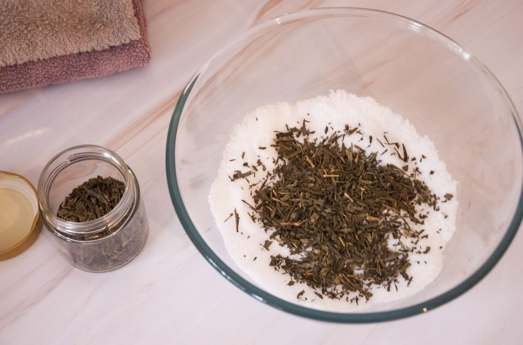 diy foot soak in the bowl with added green tea leaves