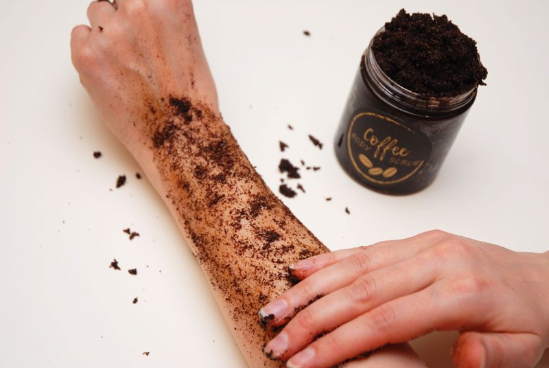 applying homemade coffee scrub on the skin for best exfoliation