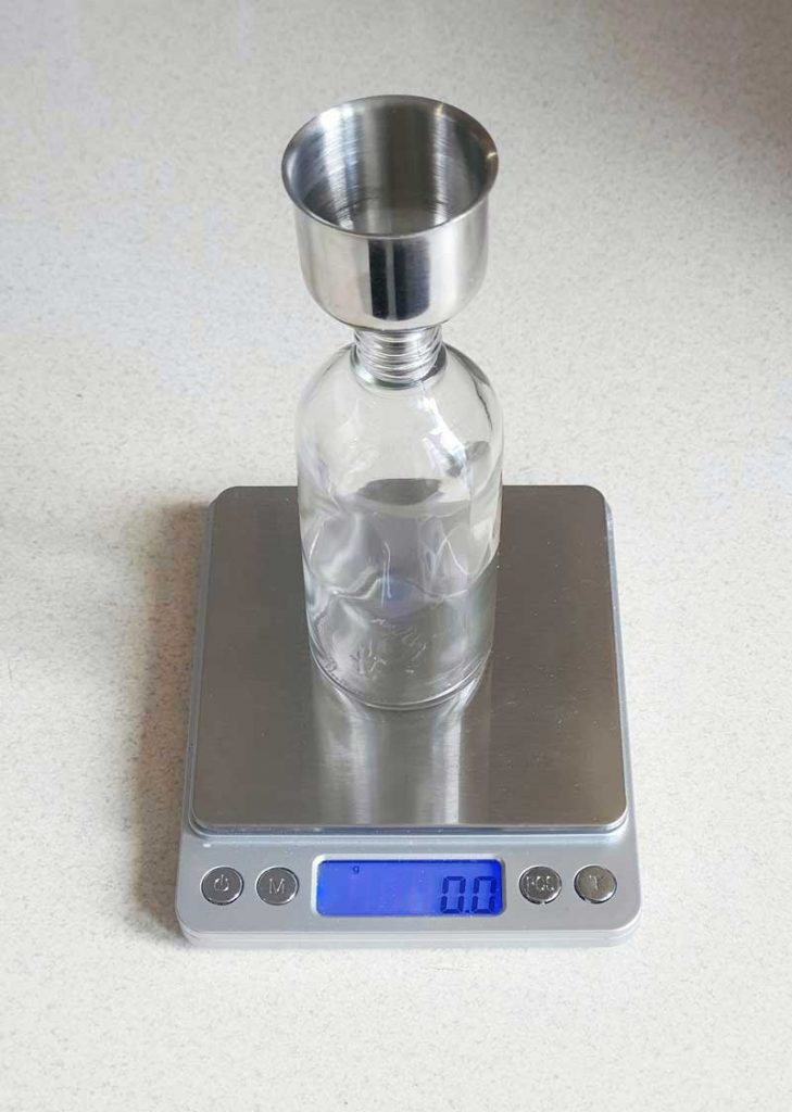 weighting oil using scales