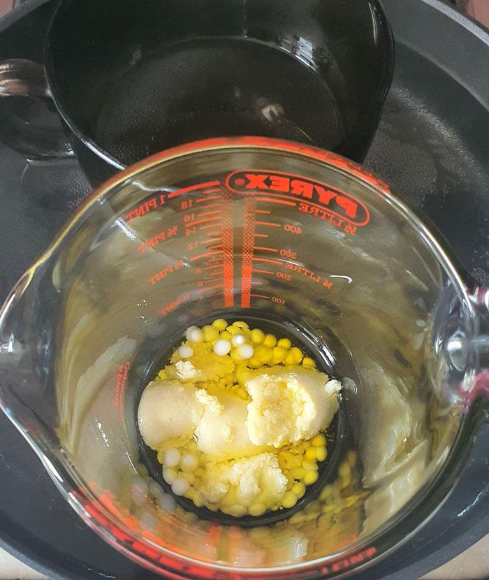 melting shea butter, emulsifier and oils for lotion