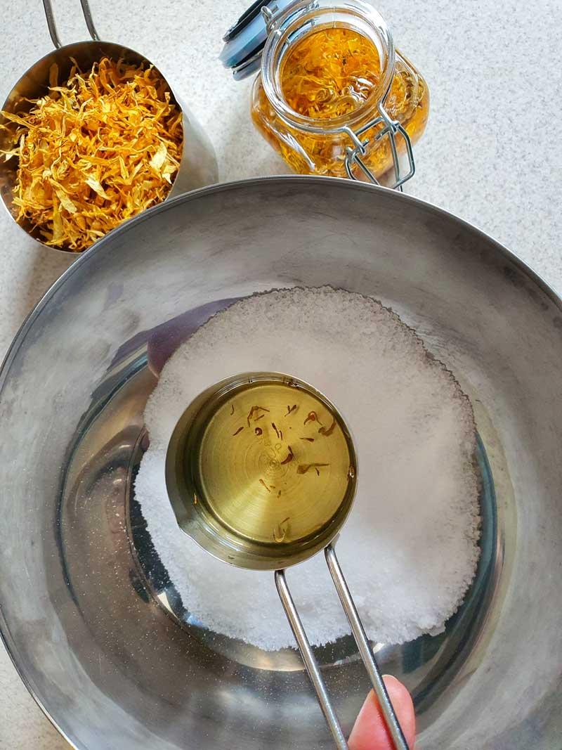 adding calendula infused oil to bath salts
